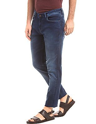 True Blue Mid Rise Tapered Fit Jeans